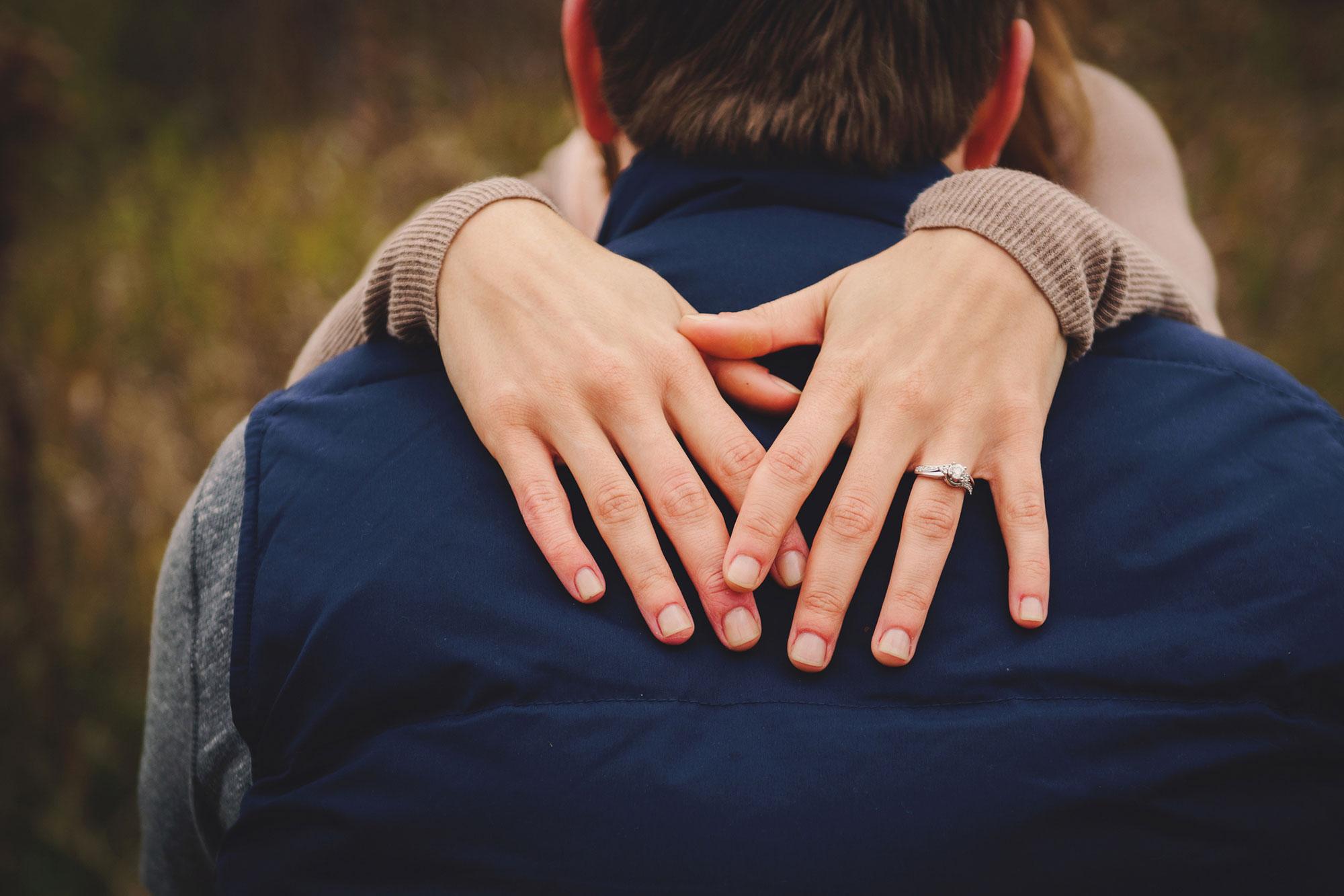 Newly engaged couple embracing